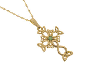 gold Celtic design cross with natural emeralds